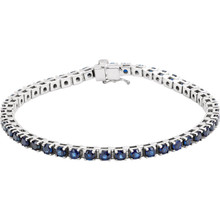 "Striking in design, this petite sapphire 7"" bracelet features 46 rich blue sapphires set in platinum with a box catch clasp and hidden safety."