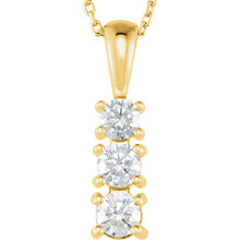 This beautiful three stone journey diamond necklace is sure to please. This lasting symbol of your loving journey as one, this graduating diamond journey pendant of 14k gold hangs off of a matching chain of 18 inches. With approximately 1/2 carat of round, near colorless diamonds this journey pendant kicks off amazing fire and light, making it the perfect accessory for any special occasion.