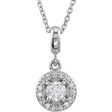 If you want to make a real entrance, don this dramatic diamond pendant necklace. All eyes will be on you and your jeweled d'colletage. You will be instantly transfixed into the one they all want to know even if they are not the actual guest of honor. Set in 14K white gold, this pendant weighs 1/4 ct. tw. and has a bright polish to shine.