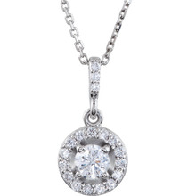 14 karat white gold diamond necklace featuring shimmering white diamonds which articulate beautifully. The total carat weight of white diamonds is 1/2 carat.