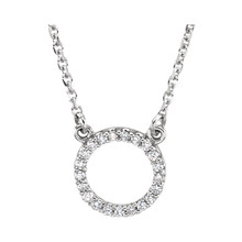 This necklace features a dazzling assortment of round diamonds set in a circle of 14K white gold. Comes with an 16.5 Inch necklace. The total diamond weight is 1/10 ct . A very fine piece of jewelry.
