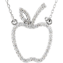 This is a gorgeous petite apple crafted in 14K white gold and comes with a 16.75 inch necklace. The total carat weight is 1/5.