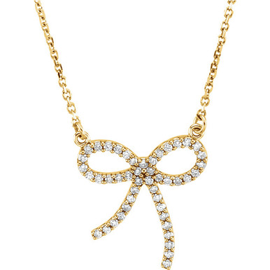 """Wonderful 14Kt yellow gold diamond bow design necklace with a total diamond carat weight of 1/4cts. hanging from a necklace with a length of 16"""" inches. Total weight of the gold is 2.02 grams."""