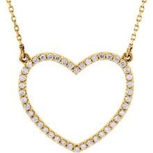 "Beautiful 14Kt yellow gold heart necklace features white shimmering diamonds with 1/3 carats of diamonds hanging from a 16"" inch chain which is included."
