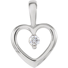 "Beautiful 14Kt white gold heart necklace features a single white shimmering diamond with .07 carats hanging from a 18"" inch solid rope chain which is included."
