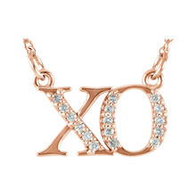 It's a different, more stylish kind of public display of affection! This charming pendant features the traditional symbols of hugs and kisses set with glittering diamond accents. The style suspends from an 16.0-inch solid chain and secures with a spring-ring clasp.