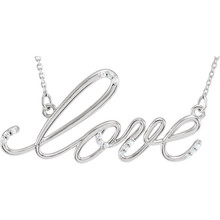 """""""Love"""" Design Necklace featuring a 0.08 ct. tw. round genuine diamonds. It is a truly unique and a fantastic choice. Diamonds are G-H in color and I1 or better in clarity. The style suspends from an 18.00-inch diamond cut cable chain and secures with a spring-ring clasp."""