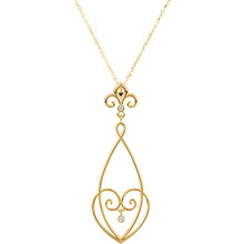 """Beautiful 14Kt yellow gold Fleur-De-Lis necklace features white shimmering diamonds with .05 carats of diamonds hanging from a 18"""" inch chain which is included."""