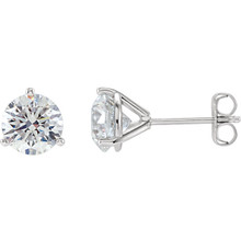 Brilliance is captured in these diamond stud earrings showcasing round diamonds in three-prong settings of 14k white gold. The pair amounts to a 2 carat total diamond weight.