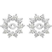 Dress up your favorite solitaire stud earrings with a halo of diamonds with this glittering pair of earring jackets. Simply place the post of your own earring through the center hole in the earring jacket to create a fresh new look.  Each earring is set with 10 prong-set round diamonds in a jacket crafted of 14k white gold. Diamonds are rated G-H for color, I1 for clarity, with a total 5/8 carat weight. Earrings are a size 10.50mm and a bright polish to shine.  Studs are not included.
