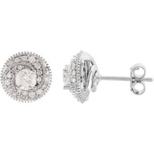 These petite diamond stud earrings are set in 14k white gold with 44 round diamonds framing a round center diamond for incredible brilliance.