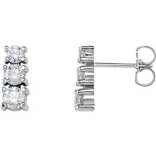 Bold and brilliant, these diamond 3 stone earrings are a sparkling look, perfect for that special evening out. Crafted in cool 14K white gold, each earring features three shimmering prong-set diamonds that are G-H in color and I1 or better in clarity. Radiant with 9/10 ct. t.w. of diamonds and polished to a brilliant shine, these post earrings secure comfortably with friction backs.
