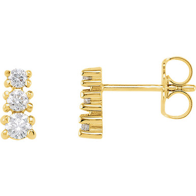 Bold and brilliant, these diamond 3 stone earrings are a sparkling look, perfect for that special evening out. Crafted in cool 14K yellow gold, each earring features three shimmering prong-set diamonds that are G-H in color and I1 or better in clarity. Radiant with 3/8 ct. t.w. of diamonds and polished to a brilliant shine, these post earrings secure comfortably with friction backs.