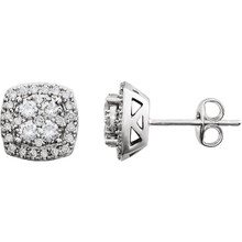 Superb style is found in these 14Kt white gold halo-style cluster earrings accented with the brilliance of round full cut diamonds. Total weight of the diamonds is 3/4 carats.