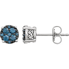 Superb style is found in these 14Kt white gold cluster earrings accented with the brilliance of blue diamonds. Total weight of the diamonds is 3/8 carat.