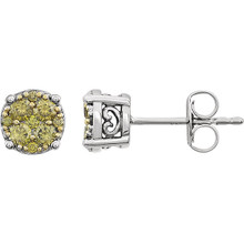 Superb style is found in these 14Kt white gold cluster earrings accented with the brilliance of yellow diamonds. Total weight of the diamonds is 3/8 carat.