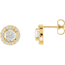 Dazzling diamonds are always an excellent choice and she'll absolutely adore these delightful studs. Fashioned in 14K yellow gold, each earring showcases a beautiful round diamond center stone surrounded by a double frame of smaller accent diamonds. Sparkling with 1 ct. t.w. of diamonds and finished with a bright polish, these post earrings secure comfortably with friction backs.
