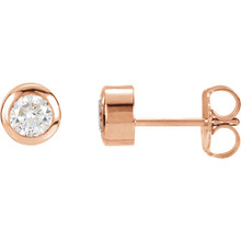 These are a beautiful pair sparking center diamonds in these lovely earrings. Crafted in romantic 14K rose gold, the earrings have a total diamond weight of 1.00 carat and are secured with friction backs.