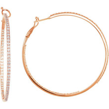 Classic in style, these diamond hoop earrings feature round diamonds prong-set throughout the 14k rose gold settings.