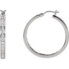 Elevate your look with a touch of sparkle. These unique diamond channel-set hoop earrings feature round-cut diamonds (1.00 ct. t.w.) in 14k white gold. Polished to a brilliant shine.