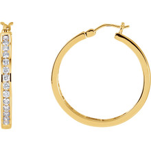 Elevate your look with a touch of sparkle. These unique diamond channel-set hoop earrings feature round-cut diamonds (1.00 ct. t.w.) in 14k yellow gold. Polished to a brilliant shine.