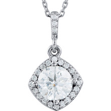 An impressive round diamond framed in additional round diamonds is the focal point of this extraordinary necklace for her. The pendant, fashioned in 14K white gold, is suspended from an 18-inch chain secured with a spring ring clasp. The total diamond weight is 7/8 carats.