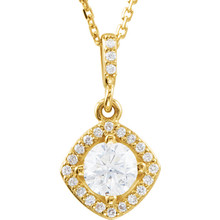 An impressive round diamond framed in additional round diamonds is the focal point of this extraordinary necklace for her. The pendant, fashioned in 14K yellow gold, is suspended from an 18-inch chain secured with a spring ring clasp. The total diamond weight is 5/8 carats.