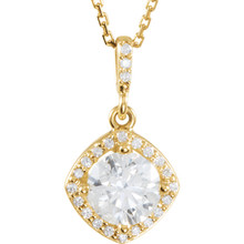 An impressive round diamond framed in additional round diamonds is the focal point of this extraordinary necklace for her. The pendant, fashioned in 14K yellow gold, is suspended from an 18-inch chain secured with a spring ring clasp. The total diamond weight is 1 1/6 carats.