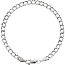 "Solid Charm 7"" Bracelet In Sterling Silver measures 4mm in width and has a bright polish to shine."