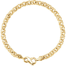 "Solid Charm 7"" Bracelet In 14K Yellow Gold measures 4.5mm in width and has a bright polish to shine."