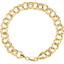 "Fashioned with polished 14K yellow gold, this 7.25"" double link charm bracelet features solid links and measures 5.7mm in width."