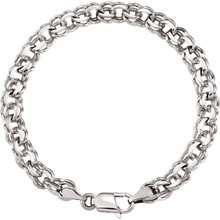 "Fashioned with polished 14K white gold, this 7"" charm bracelet features solid links and measures 7.00mm in width."