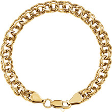 "Fashioned with polished 14K yellow gold, this 7"" charm bracelet features solid links and measures 7.00mm in width."