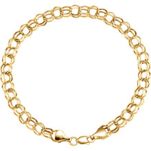 "Fashioned with polished 14K yellow gold, this 7.25"" hollow double link charm bracelet features solid links and measures 7.90mm in width."