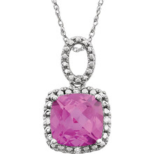 "Exquisite 14Kt white gold pendant captures the beauty of a genuine 9.00mm cushion cut created pink sapphire accented by white shimmering diamonds hanging from an 18"" inch chain. Total weight of the diamonds is 0.03 total carat weight."