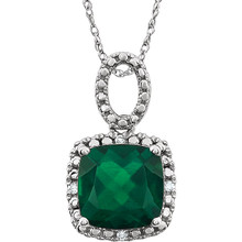 "Exquisite 14Kt white gold pendant captures the beauty of a genuine 9.00mm cushion cut created emerald accented by white shimmering diamonds hanging from an 18"" inch chain. Total weight of the diamonds is 0.03 total carat weight."