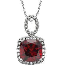 "Exquisite 14Kt white gold pendant captures the beauty of a genuine 9.00mm cushion cut Mozambique Garnet accented by white shimmering diamonds hanging from an 18"" inch chain. Total weight of the diamonds is 0.03 total carat weight."