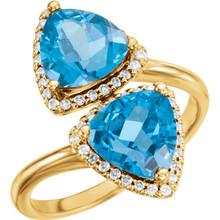 Made in yellow gold, this exquisite design features Swiss Blue Topaz gemstones accented with full cut diamonds. Both gemstones representing your friendship and loving commitment.