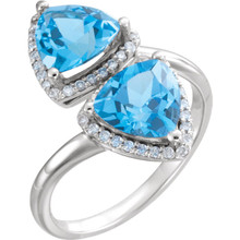 Made in Platinum, this exquisite design features Swiss Blue Topaz gemstones accented with full cut diamonds. Both gemstones representing your friendship and loving commitment.
