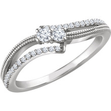 Stand out with this stunning two-stone ring, beautifully crafted of 14-karat white gold and set with genuine diamonds. A high polish finish completes the ring with a radiant shine. Both diamonds representing your friendship and loving commitment.