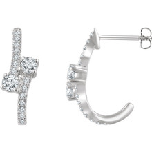Celebrate your life together with these exquisite diamond J-hoop earrings. Crafted in 14K white gold, these meaningful designs each features two shimmering 1/6 ct. diamonds, representing both your friendship and loving commitment, nestled side-by-side at the center. A brilliant metaphor for your romantic love story, these earrings captivate with 5/8 ct. t.w. of diamonds and a bright polished shine. The earrings secure with friction backs.