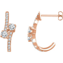 Celebrate your life together with these exquisite diamond J-hoop earrings. Crafted in 14K rose gold, these meaningful designs each features two shimmering 1/6 ct. diamonds, representing both your friendship and loving commitment, nestled side-by-side at the center. A brilliant metaphor for your romantic love story, these earrings captivate with 5/8 ct. t.w. of diamonds and a bright polished shine. The earrings secure with friction backs.