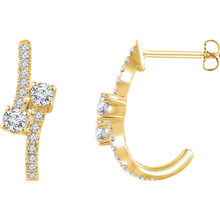 Celebrate your life together with these exquisite diamond J-hoop earrings. Crafted in 14K yellow gold, these meaningful designs each features two shimmering 1/6 ct. diamonds, representing both your friendship and loving commitment, nestled side-by-side at the center. A brilliant metaphor for your romantic love story, these earrings captivate with 5/8 ct. t.w. of diamonds and a bright polished shine. The earrings secure with friction backs.