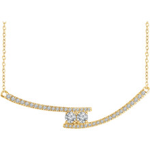Chic and sparkling, this diamond two stone necklace features round diamonds in 14k yellow gold, and a matching cable chain. This necklace can be worn at 16 or 18 inches in length.