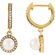 Beautiful 14Kt yellow gold earrings featuring cultured pearls with 1/5 total carat weight of diamonds.