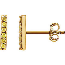 These fashionable earrings are pave set with stunning yellow diamonds to create an elegant glitter. The lustrous yellow gold setting enhances the beauty, and creates a simple yet luxurious vertical bar.