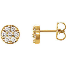Superb style is found in these 14k yellow gold cluster earrings accented with the brilliance of round full cut white diamonds.
