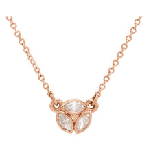 "Beautiful 14Kt rose gold 3-stone marquise necklace featuring white shimmering diamonds with 1/4 carats of diamonds hanging from a adjustable 16-18"" inch cable chain. Polished to a brilliant shine."