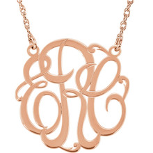 Give her a classic necklace that is personal and individual for her. Fashioned in 14k rose gold, a circle frames three initials of your choice, in an elegant flowing script monogram font. Enter the initials in the order you would like them. Polished to a bright shine, the pendant suspends on a rope chain that secures with a spring-ring clasp.