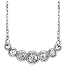 """Beautiful 14Kt White gold graduated bezel set 1/5 ct. tw. diamond necklace hanging from a 16-18"""" inch chain which is included."""